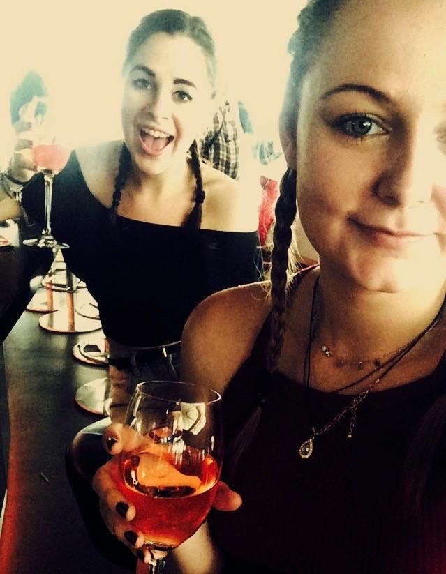 Two ladies holding wine glasses