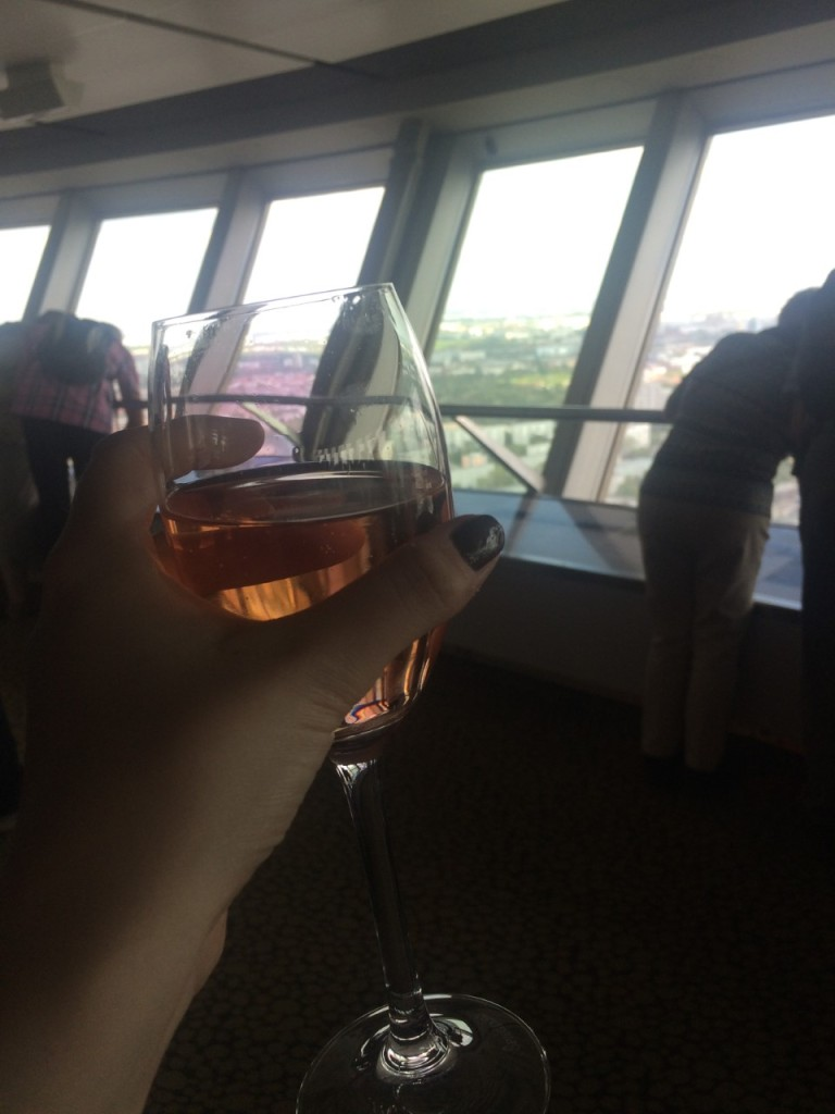Holding up a rose wine glass