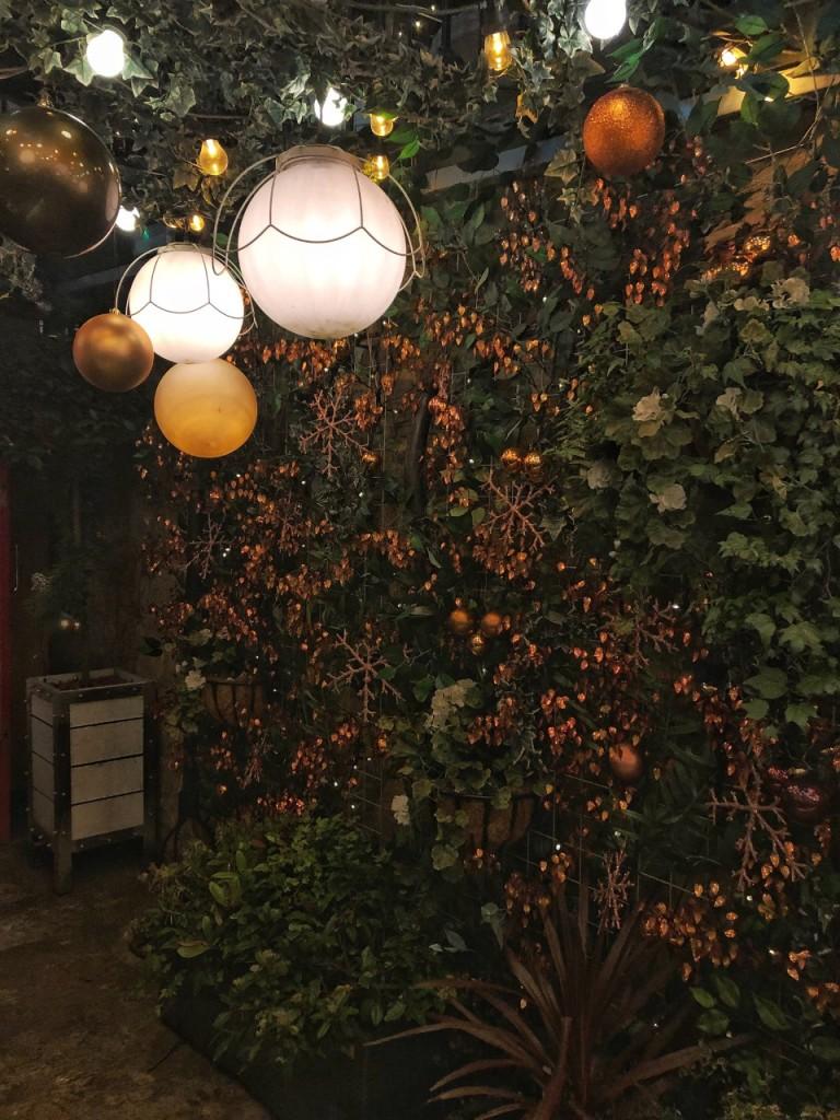 Festive flower wall outside Copper Blossom