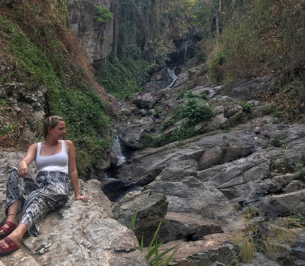 Woman looking over waterfall at the Doi Suthep Pui National park