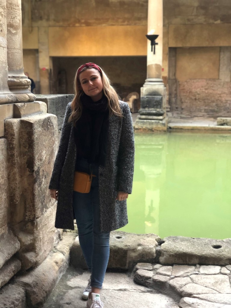 Girl standing in front of the roman baths