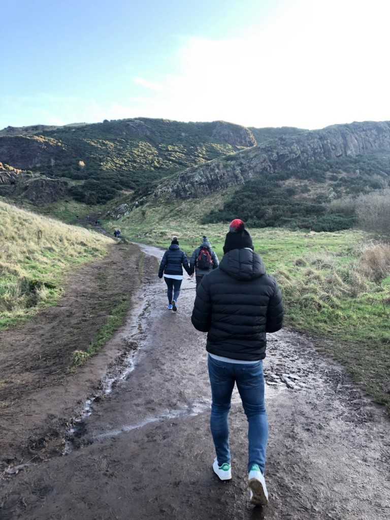 People walking towards the hills of Arthurs Seat
